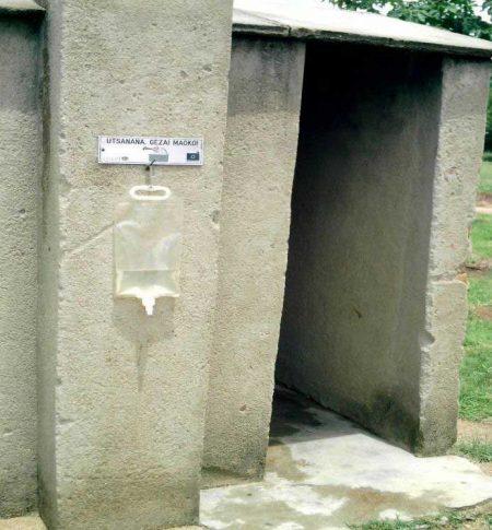 Low Flow Water Dispenser Outside Latrine